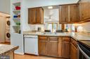 Adorable kitchen with pass through to living room - 413 LIBERTY BLVD, LOCUST GROVE