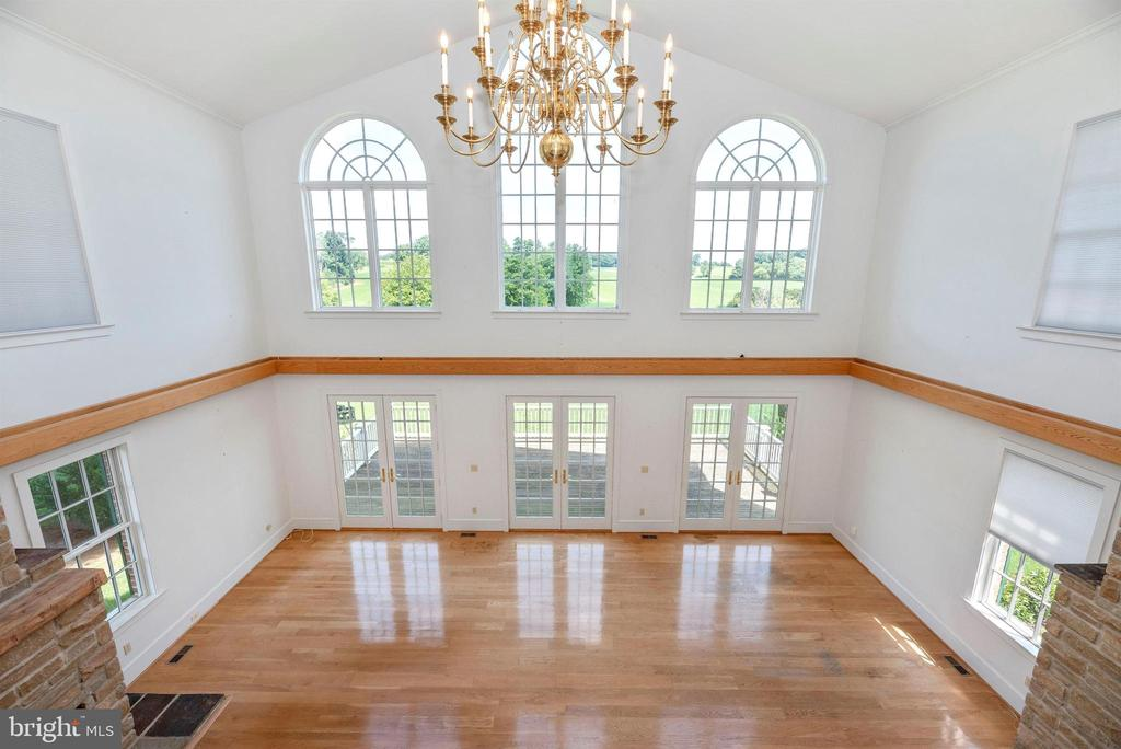 From 2nd floor, view of pasture, fireplace & deck. - 7030 DRUMMINE RD, MOUNT AIRY