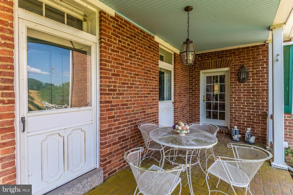 Deep covered side porch off kitchen and ballroom. - 7030 DRUMMINE RD, MOUNT AIRY