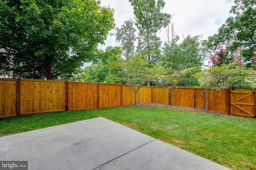 New Fence in the backyard with patio - 18857 ACCOKEEK TER, LEESBURG