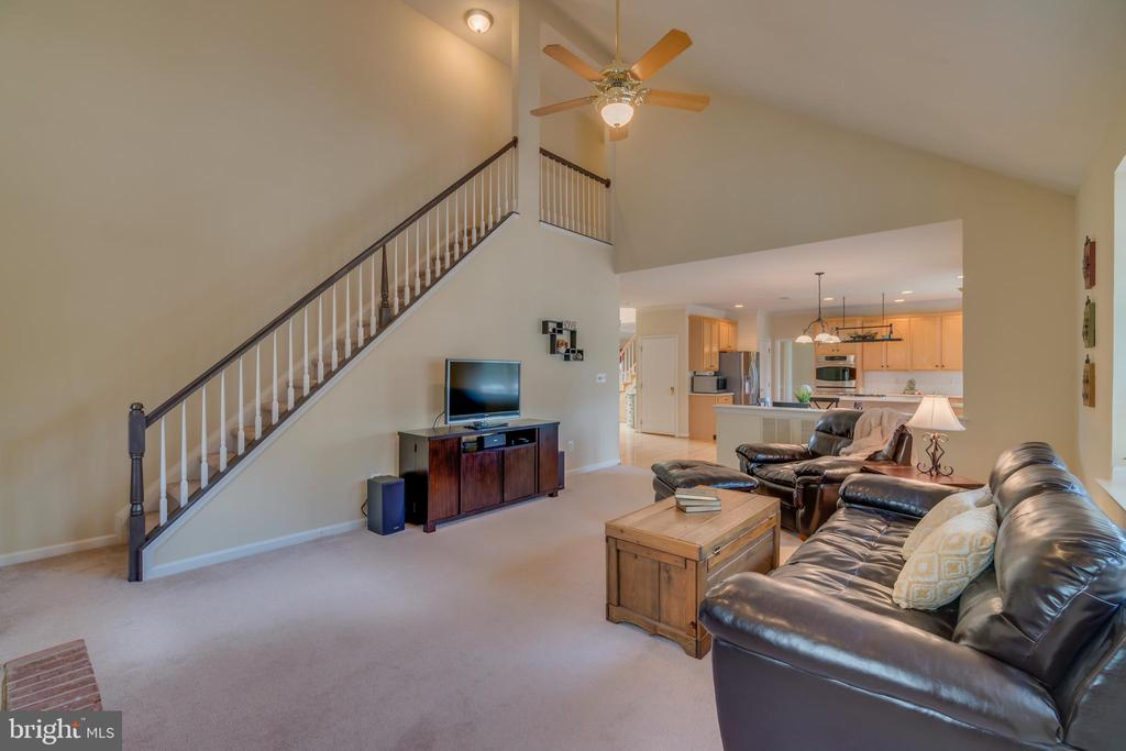 Large family room with rear staircase - 19920 HAZELTINE PL, ASHBURN