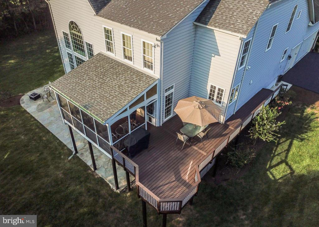 The deck wraps around the side of the house. - 42294 IRON BIT PL, CHANTILLY