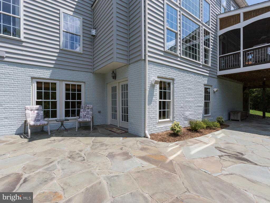 Walk out of the basement to the large stone patio. - 42294 IRON BIT PL, CHANTILLY