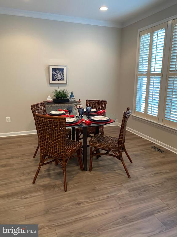 Breakfast room with luxury vinyl floors - 42939 PARK BROOKE CT, BROADLANDS