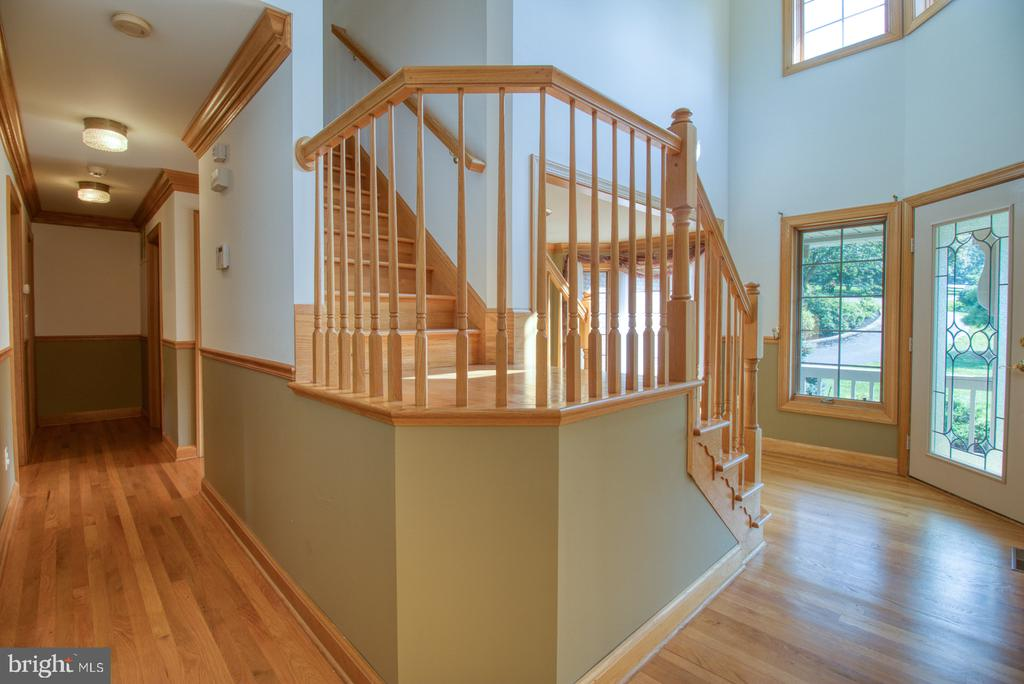 Front foyer and staircase to second level - 14016 HARRISVILLE RD, MOUNT AIRY
