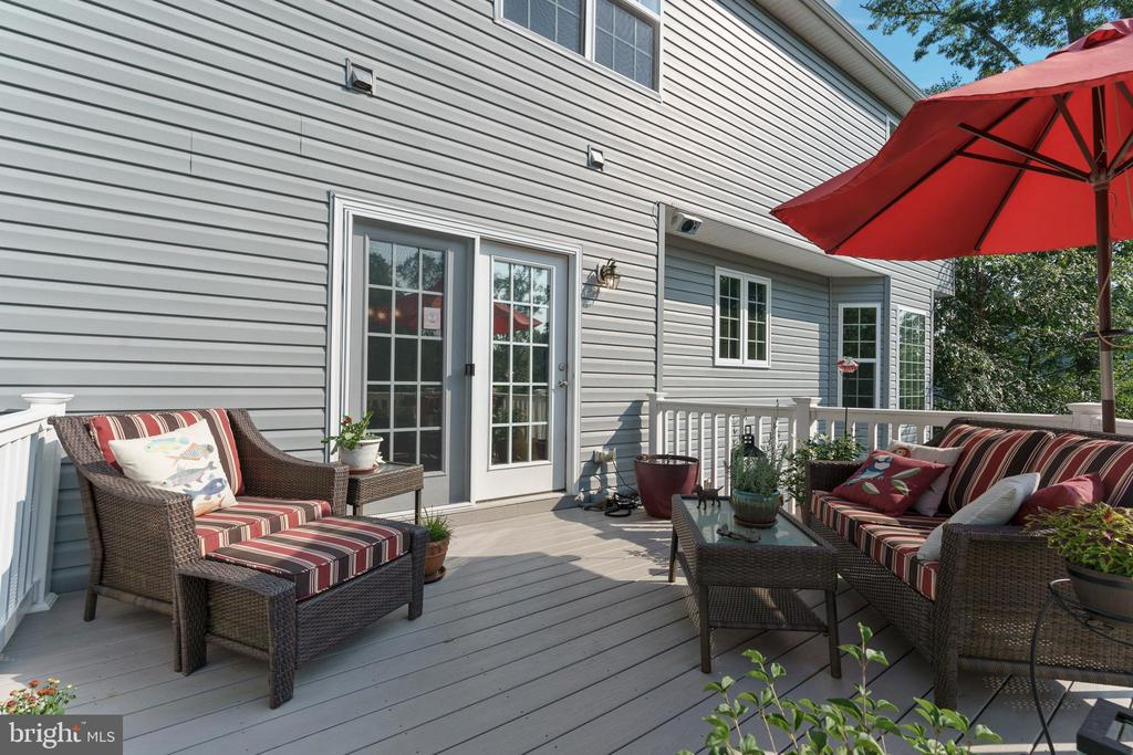 Composite deck overlooks inlaid patio and pond. - 12 BLOSSOM TREE CT, STAFFORD