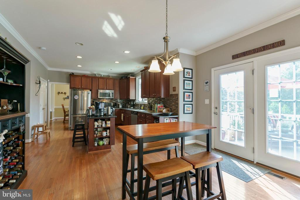 Hardwood floors.  French doors to composite deck - 12 BLOSSOM TREE CT, STAFFORD