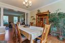 large windows and hardwood in formal dinning room - 12 BLOSSOM TREE CT, STAFFORD