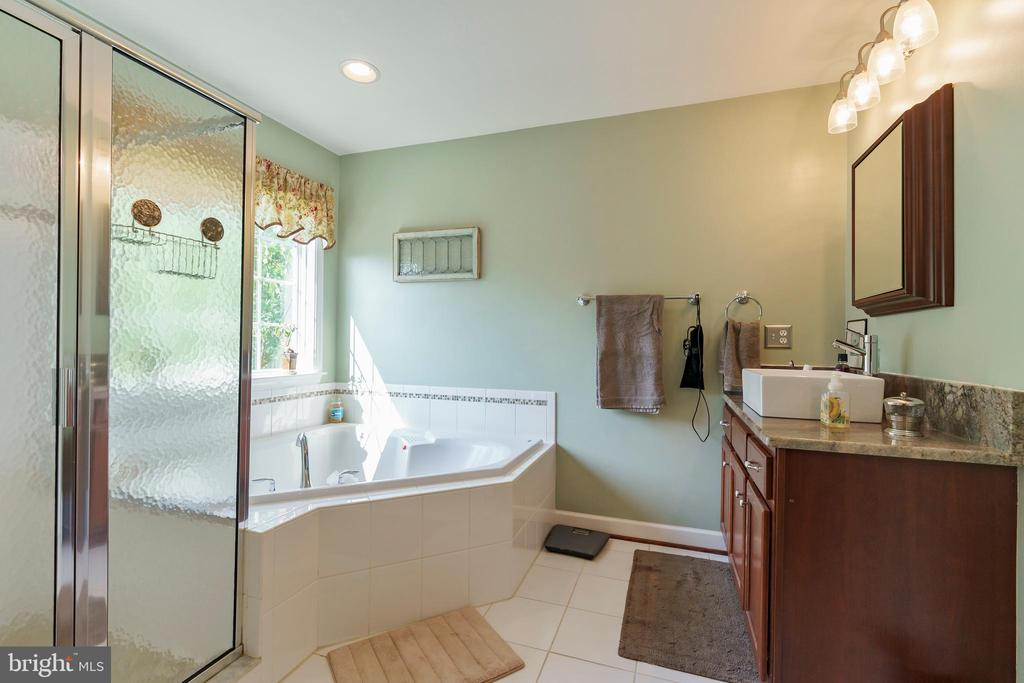 Jetted tub with large window overlooking trees. - 12 BLOSSOM TREE CT, STAFFORD