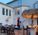 Custom Tiki bar with grill and fridge - 43264 HEAVENLY CIR, LEESBURG