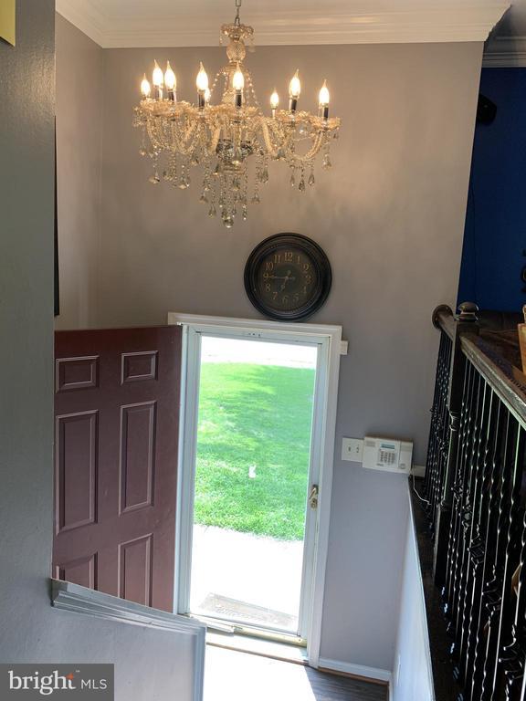 Foyer with Glass Storm Door - 9218 LANDGREEN ST, MANASSAS