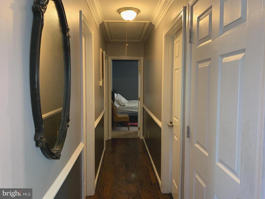 Hallway to Main Level 3 Bedrooms and 2 Baths - 9218 LANDGREEN ST, MANASSAS