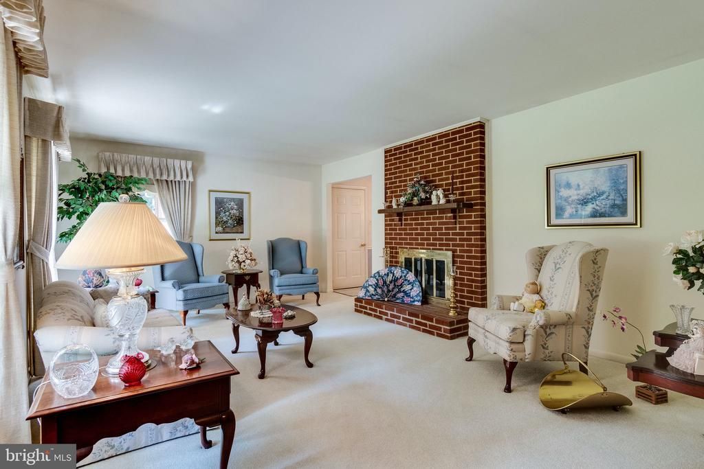 Formal living room with wood burning FP - 6906 TOKEN VALLEY RD, MANASSAS