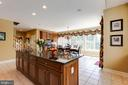 Kitchen island with granite counters - 17765 BRAEMAR, LEESBURG