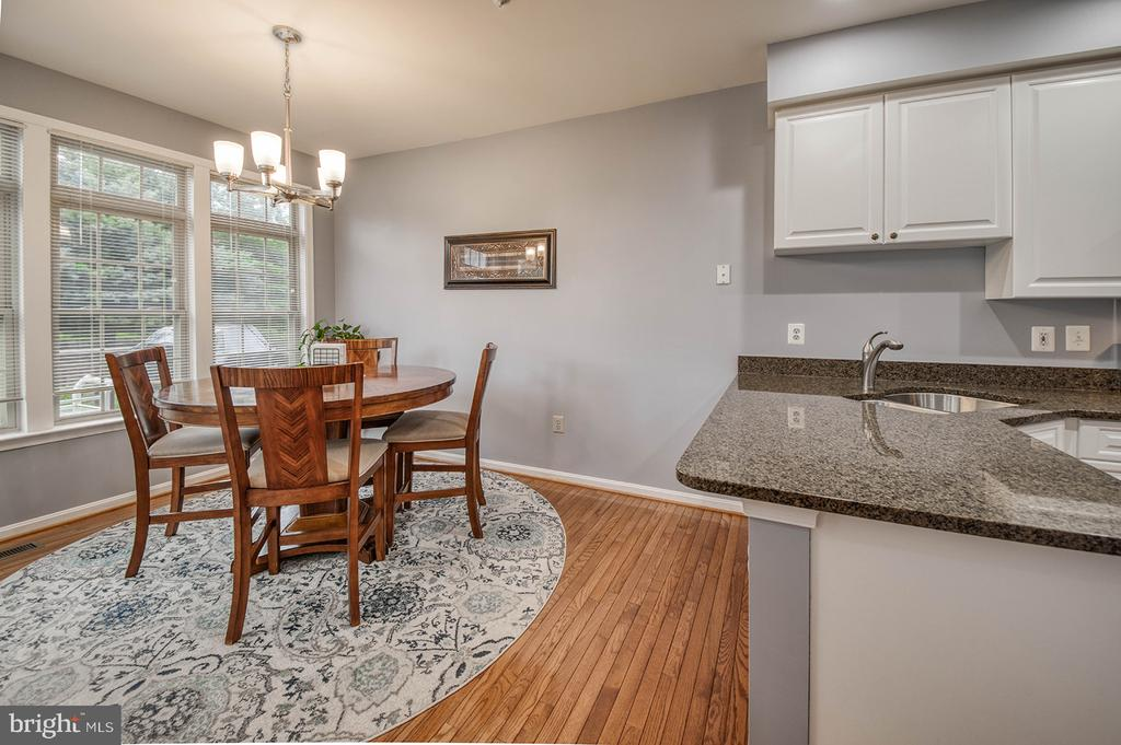Room for Bar Chairs at the Kitchen Counter - 2406 RIPPLING BROOK RD, FREDERICK
