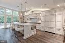 Chef's Kitchen with Calcutta Gold Counter Tops - 3629 ALBEMARLE ST NW, WASHINGTON