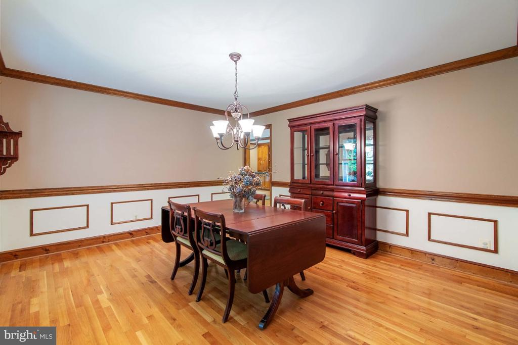 Picture frame and crown molding in large formal DR - 13613 BETHEL RD, MANASSAS