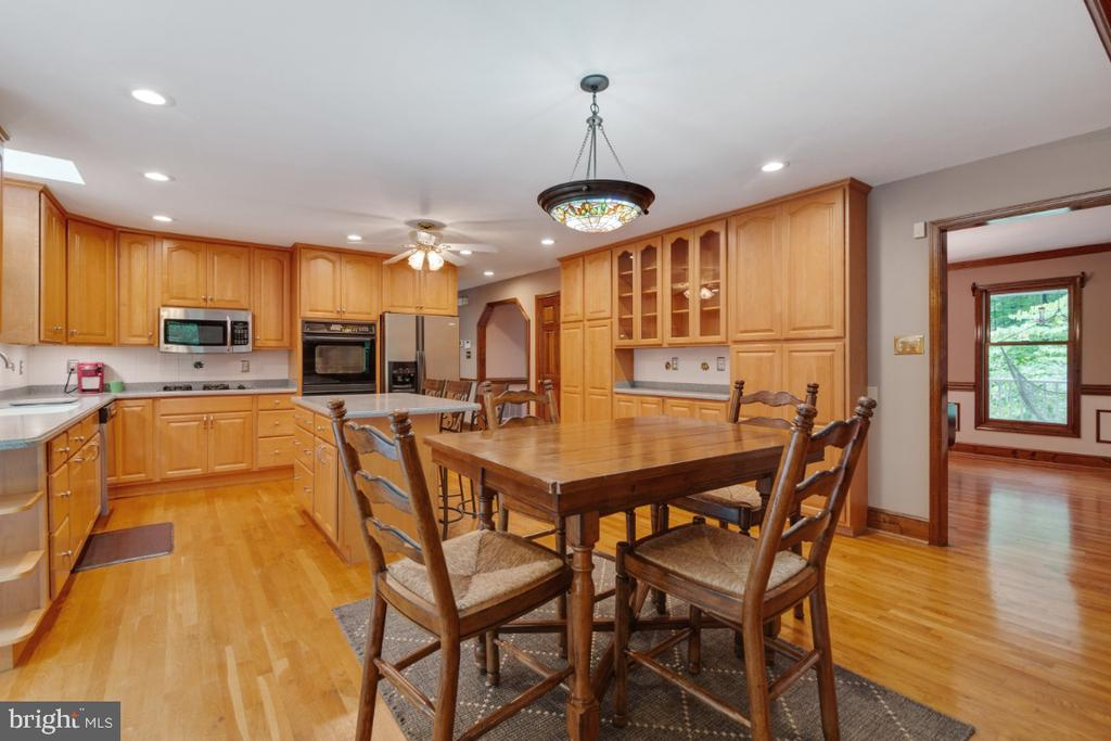The kitchen and eat in area is huge! - 13613 BETHEL RD, MANASSAS