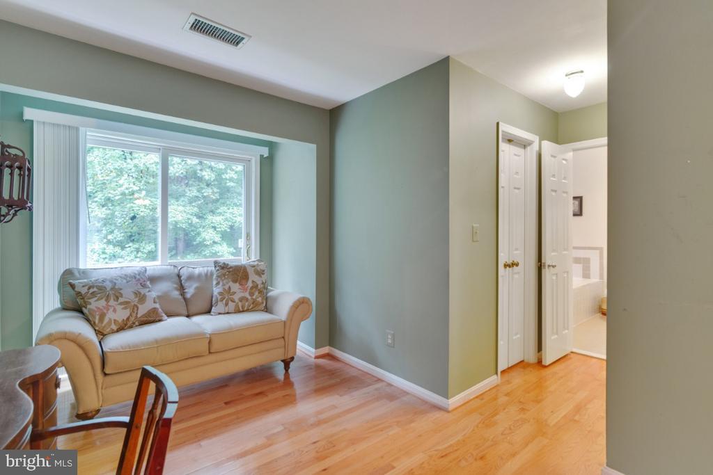 Hallway shows 2 of 3 closets in owner's suite - 13613 BETHEL RD, MANASSAS