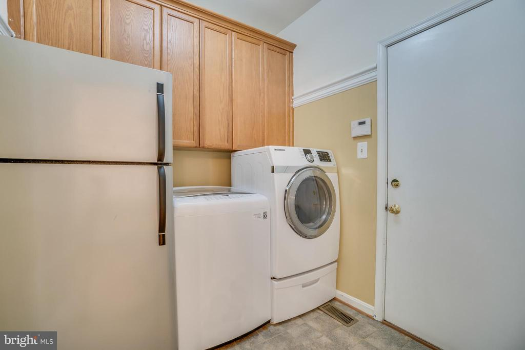 Second refrigerator, new washer and almost new dry - 5502 VILLAGE CENTER DR, CENTREVILLE