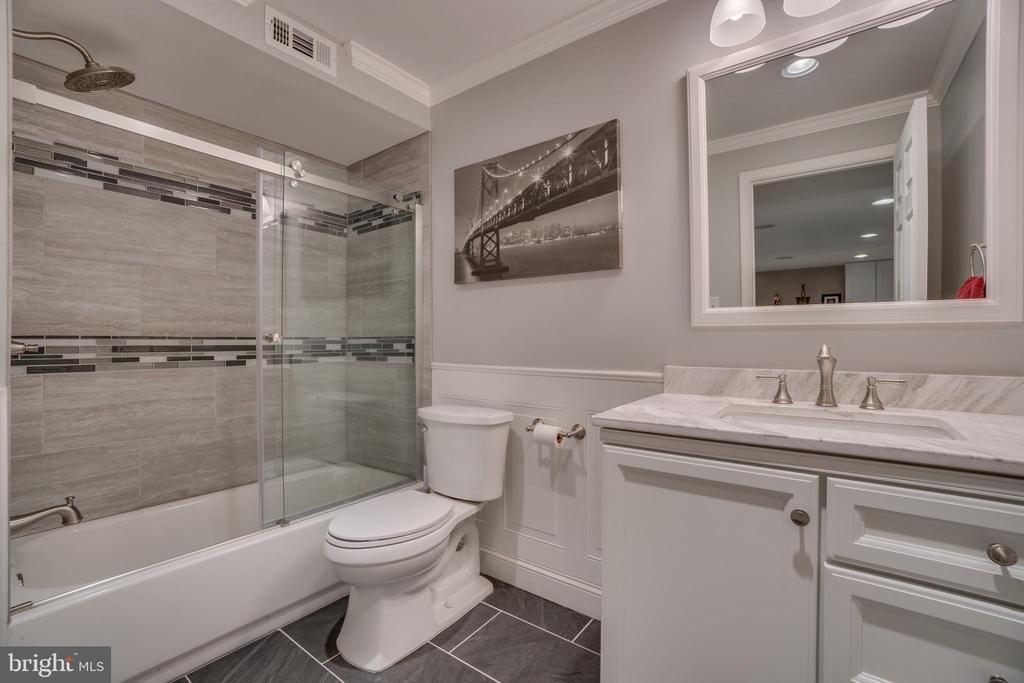 Renovated lower level bath. - 5502 VILLAGE CENTER DR, CENTREVILLE