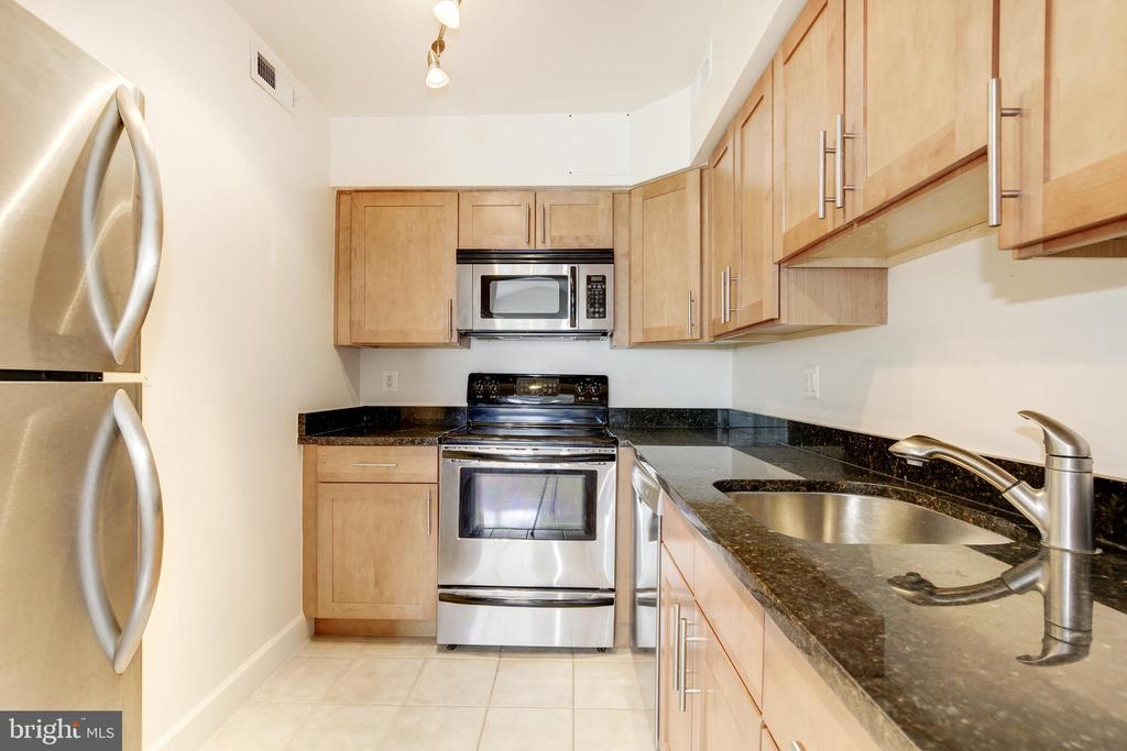 Kitchen View 1 - 3601 NW 38TH ST NW #302, WASHINGTON