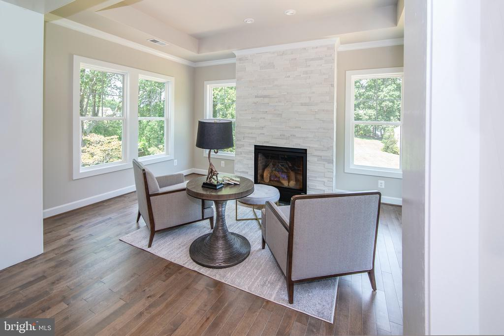 Sunlit sitting room accented by Stone  Fireplace - 9524 LEEMAY ST, VIENNA
