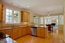 Large gourmet kitchen with granite countertops - 30831 PORTOBAGO TRL, PORT ROYAL