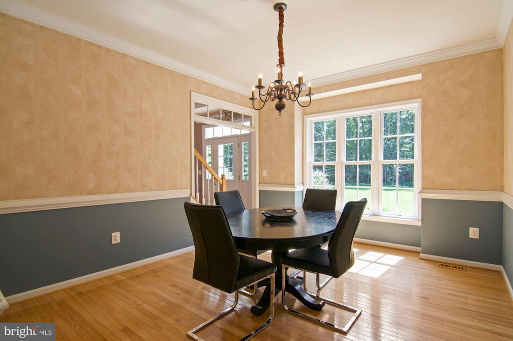 Formal dining room with chair rail and crown moldi - 30831 PORTOBAGO TRL, PORT ROYAL