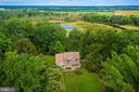 aerial view overlooking creek access from property - 30831 PORTOBAGO TRL, PORT ROYAL