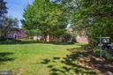 Building and unit look out at green courtyard... - 1801 KEY BLVD #10-506, ARLINGTON