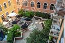 Daytime view of courtyard from balcony. - 1205 N GARFIELD ST #608, ARLINGTON