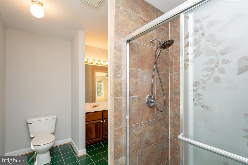 Owners Bath includes Stunning Updated Tile Shower - 12984 PINTAIL RD, WOODBRIDGE