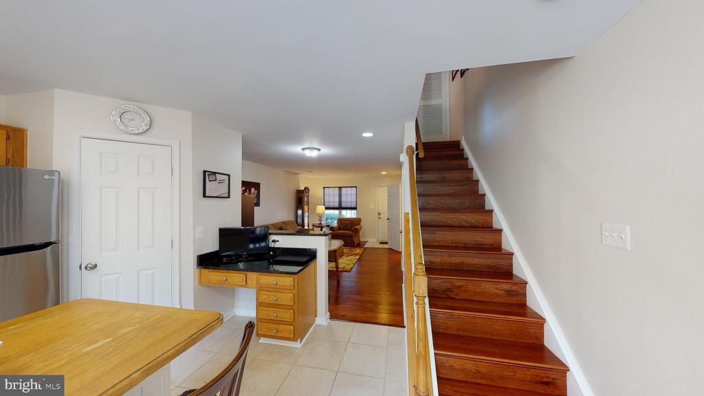 New hardwood flooring on stairs to upper level #1. - 45067 FELLOWSHIP SQ, ASHBURN