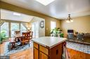 Kitchen island is the center of this great home - 10003 GRASS MARKET CT, FREDERICKSBURG