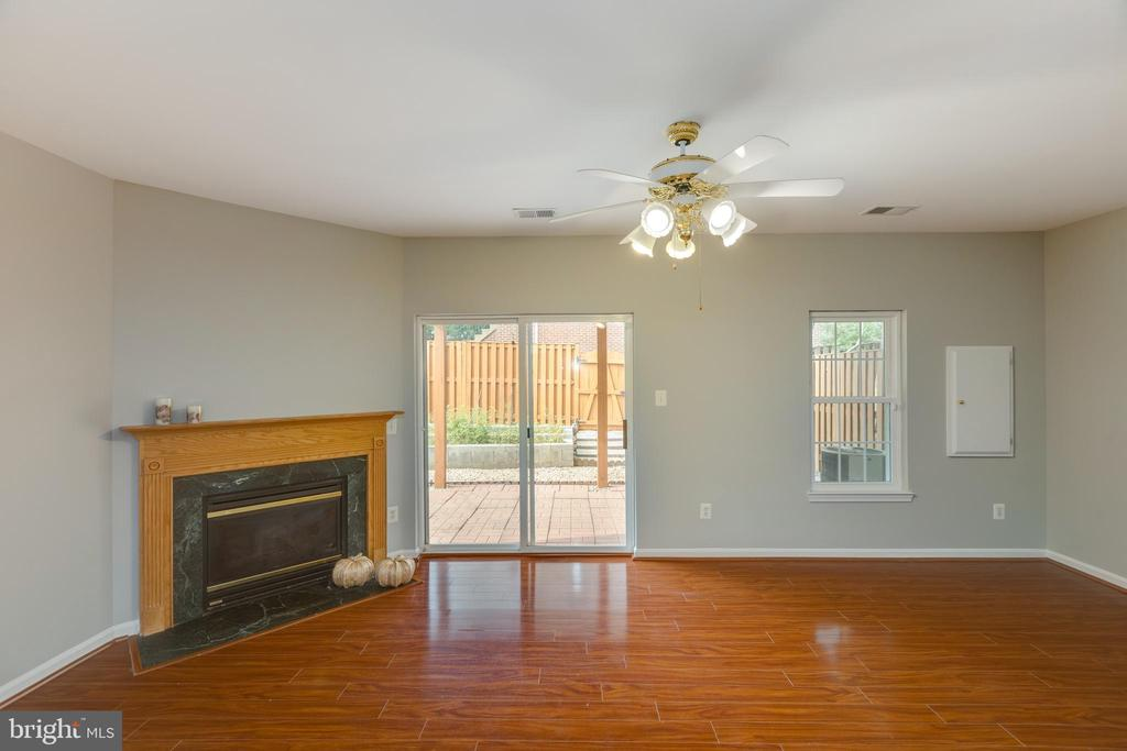Lower level rec room with cozy fireplace - 4772 BIDEFORD SQ, FAIRFAX