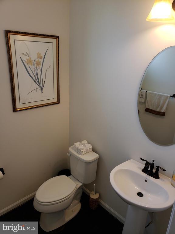 HALF BATHROOM IN FOYER HALLWAY - 12409 MAYS QUARTER RD, WOODBRIDGE