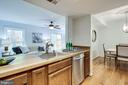 KITCHEN THAT LEADS TO DINING AREA - 2440 S WALTER REED DR #1, ARLINGTON