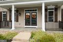 Large, inviting front porch - 20669 PERENNIAL LN, ASHBURN