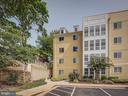 Rear patio entrance and parking lot - 4141 S FOUR MILE RUN DR #104, ARLINGTON