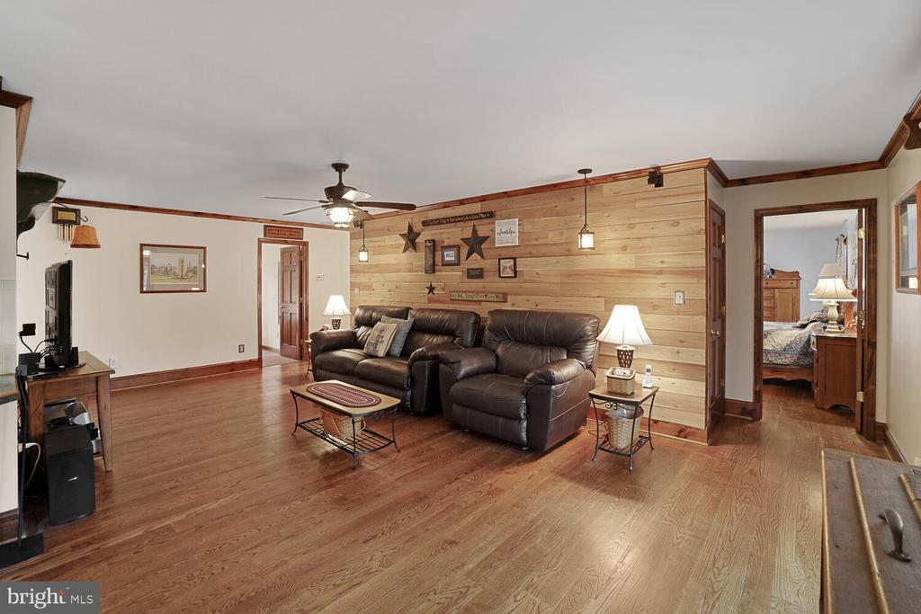 Living room with shiplap wall - 11829 CASH SMITH RD, KEYMAR
