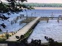 community fishing pier and boat slips - 30831 PORTOBAGO TRL, PORT ROYAL