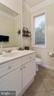 Informal Powder Room-In laundry room off kitchen. - 1414 WYNHURST LN, VIENNA