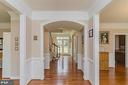 Magnificent Center Hallway with gleaming hardwood. - 43829 RIVERPOINT DR, LEESBURG