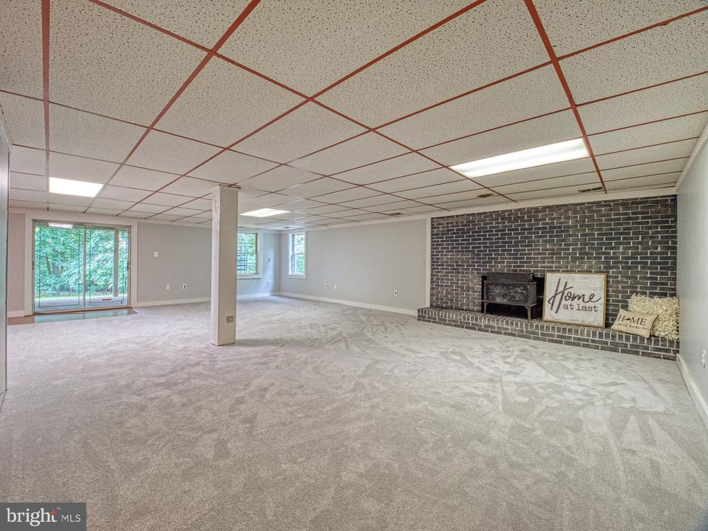 LOWER LEVEL REC ROOM WITH BRICK FIREPLACE - 1566 DRANESVILLE RD, HERNDON