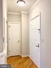 Entrance to your new home, coat closet - 1625 INTERNATIONAL DR #412, MCLEAN