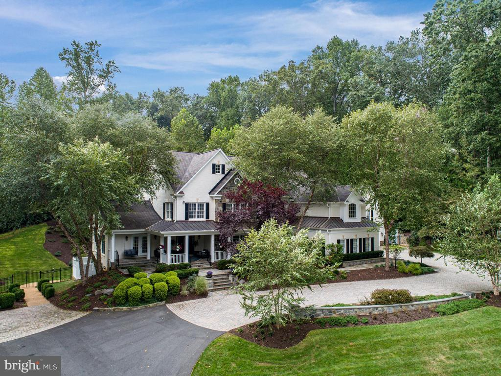 Idyllically set on a hill overlooking 5 acres - 2124 POLO POINTE DR, VIENNA