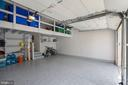 Garage with Custom Shelving and Apoxy Floors - 44220 RIVERPOINT DR, LEESBURG