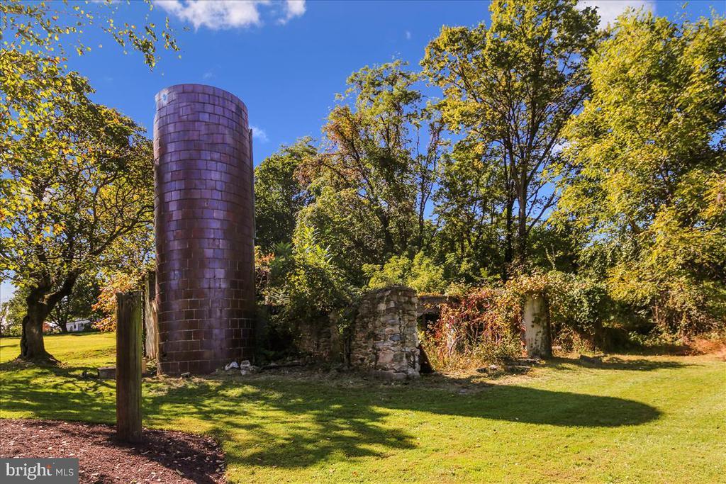 Original barn wood is gone but the silo remains. - 39860 LOVETTSVILLE RD, LOVETTSVILLE