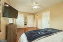 Primary Bedroom with Hardwood Floor - 919 SMARTTS LN NE, LEESBURG